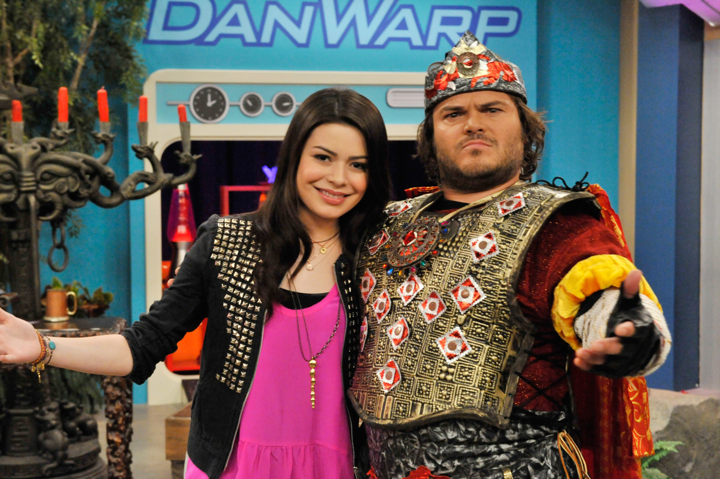 Carly poses for a photo with Jack Black, who is dressed in medieval attire for his character