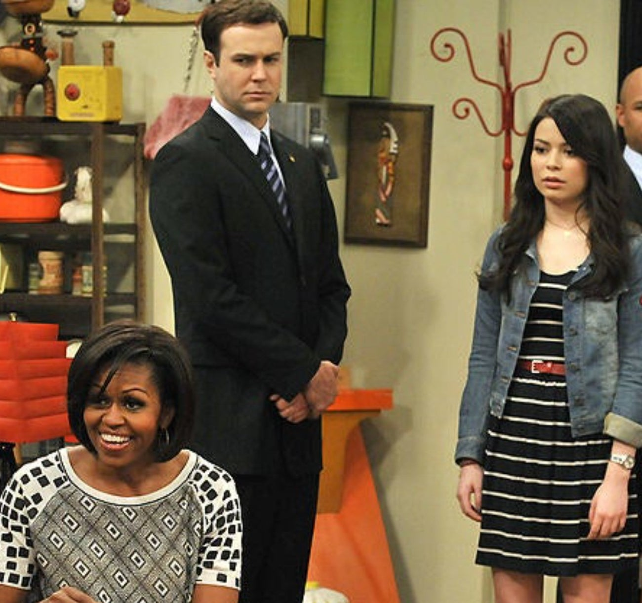 Next to Carly, Taram Killam looks serious next as one of Michelle Obama's Secret Service agents