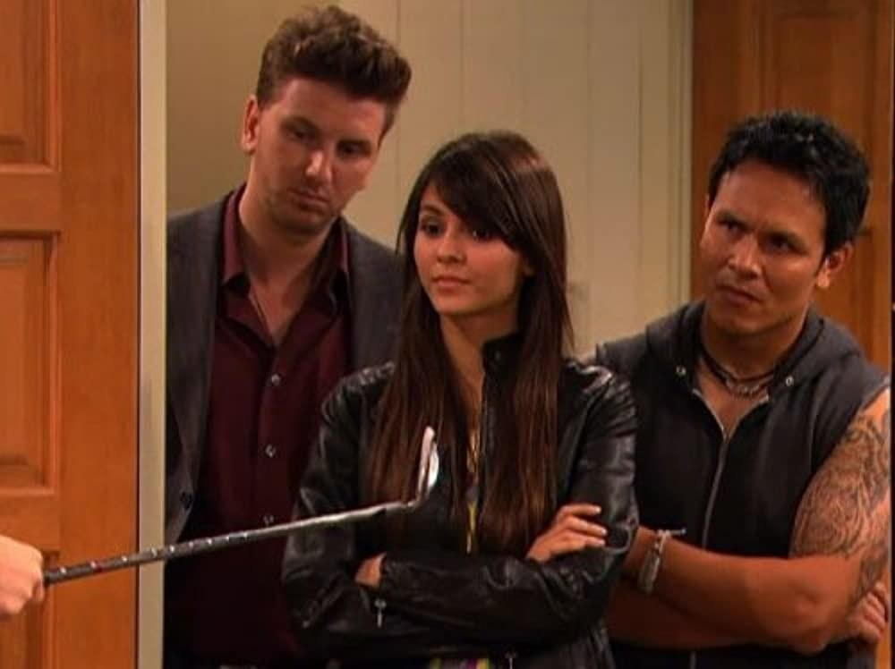 Victoria Justice looks serious while standing in the doorway, ready to talk