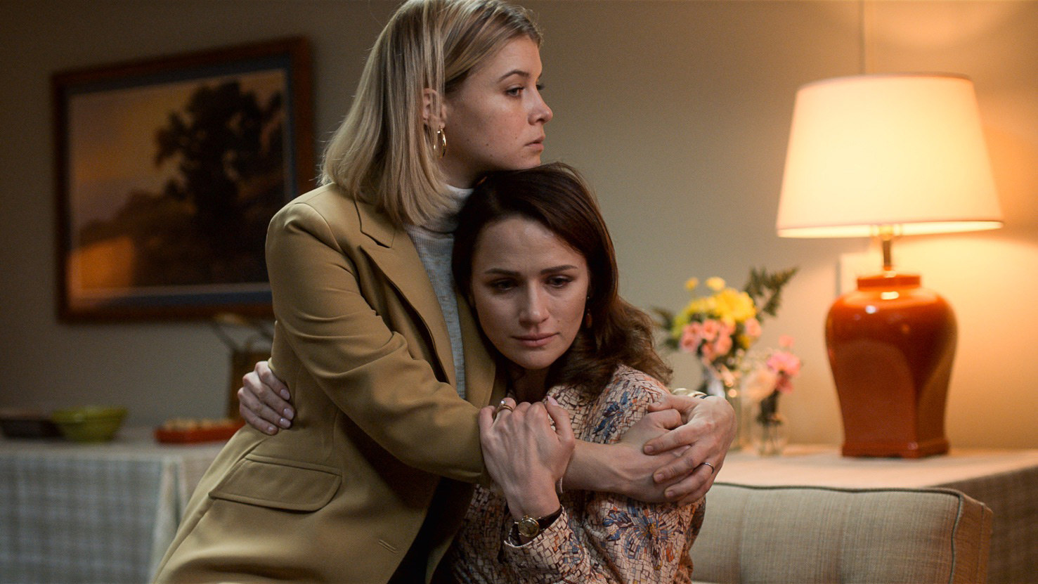 Shantel embracing someone