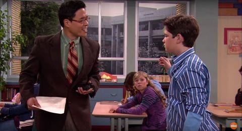 Randall Park plays a teacher while talking to Freddie, with Sam looking on in the background in dentention