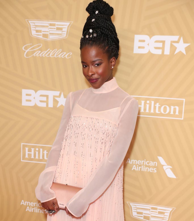 Amanda Gorman wearing a pink long sleeved dress at the american black film festival honors awards ceremony