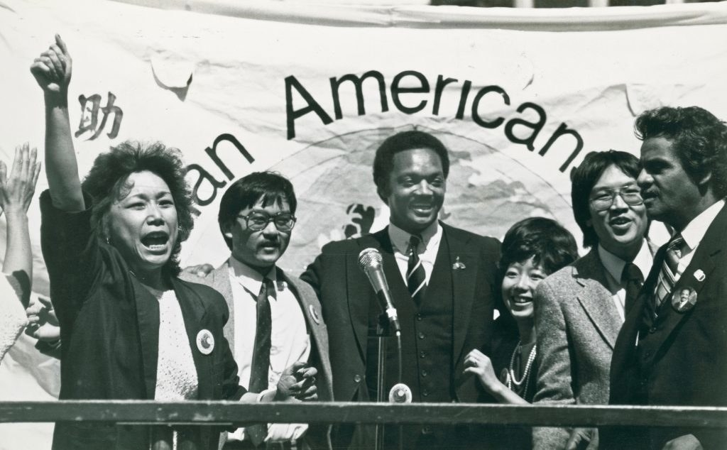 jesse jackson with fellow supporters at a rally in portsmouth square