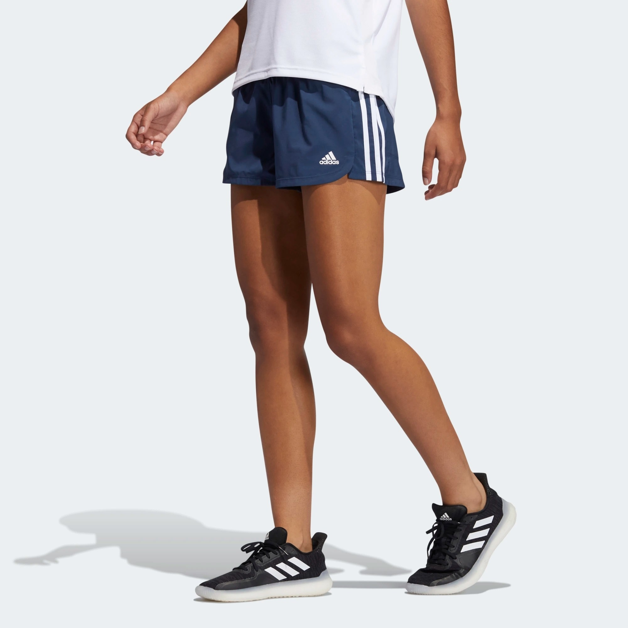 The shorts in blue and worn by a model