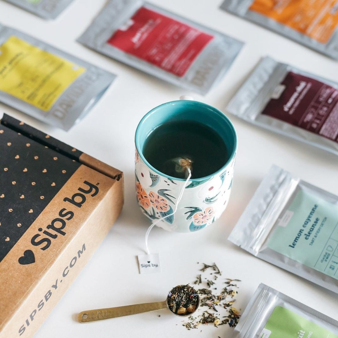 a Sips by subscription box and a mug with a teabag steeping