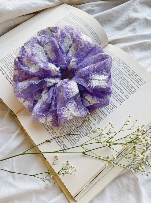 a large purple butterfly embroidered scrunchie made out of organza