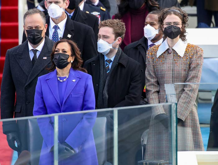 Ella stands at the inauguration with her family