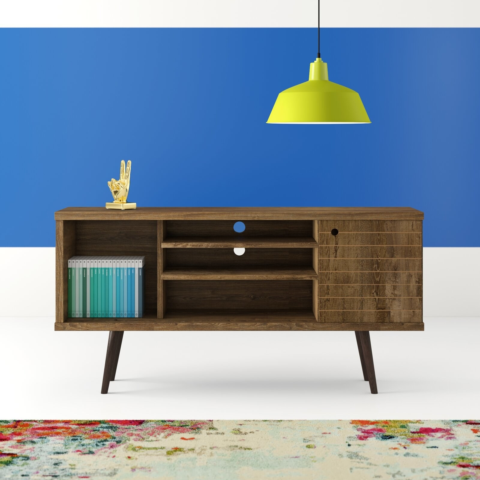 The TV stand, which has one large open cabinet at one end, one large closed cabinet at the other, and a central area with three open shelves