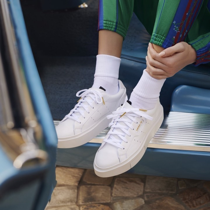 A person wearing the sneakers in a car