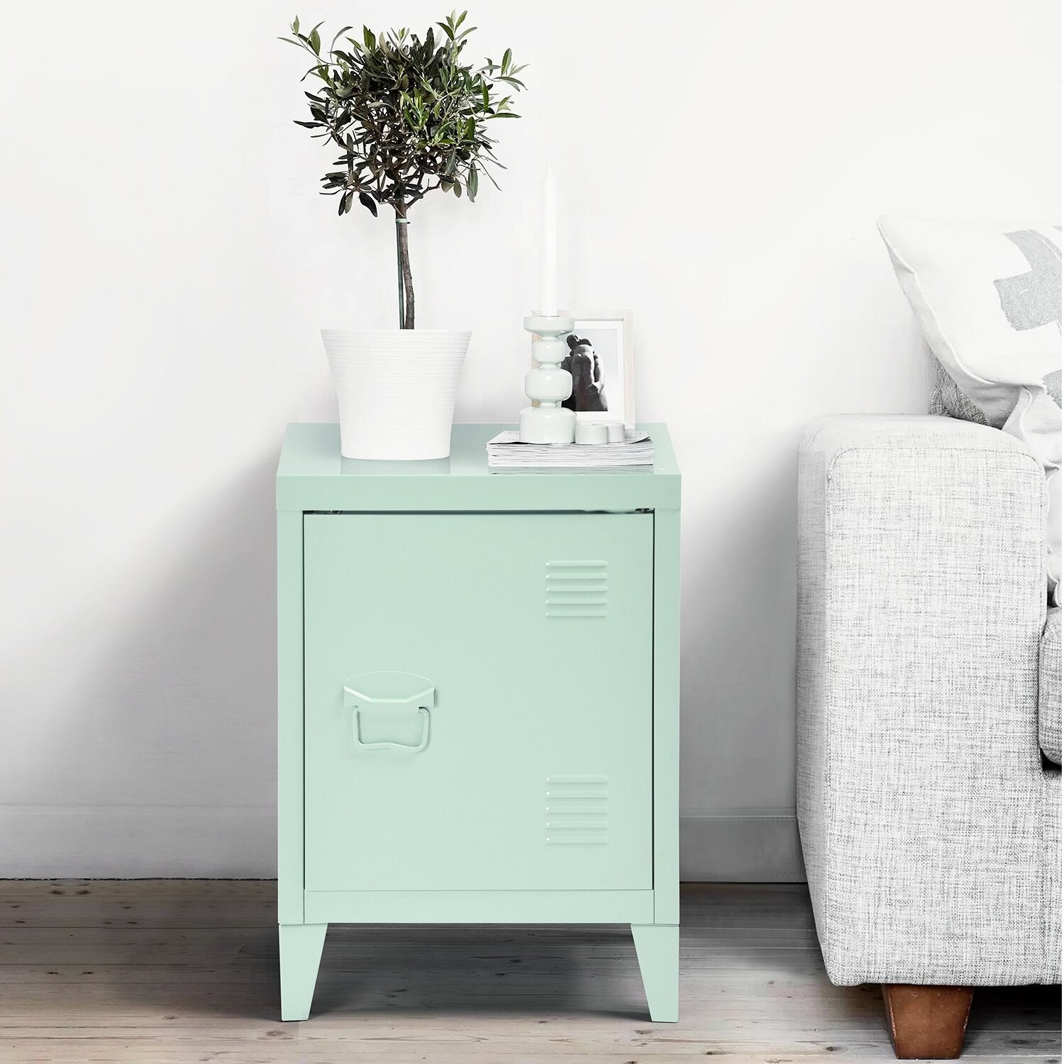 The nightstand, which has one locker-style door the opens outward, revealing two internal locker-style shelves