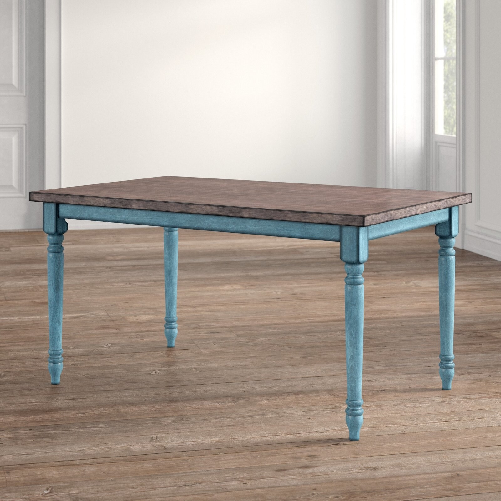 The table, which has teal legs and a brown, wood grain top