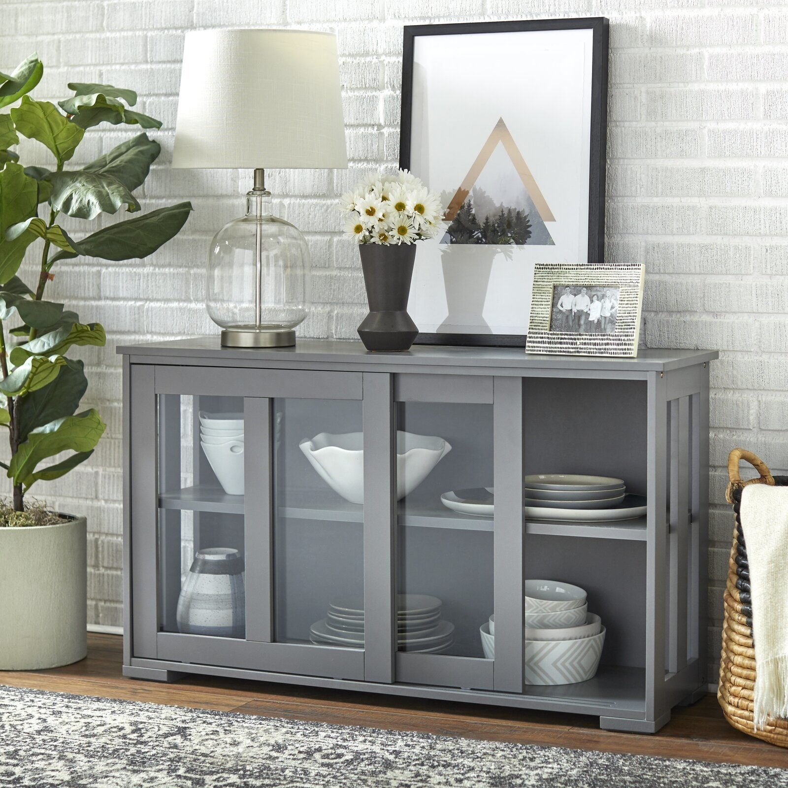 The sideboard, which has two internal shelves, and two sliding glass doors
