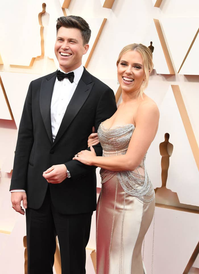 Colin Jost arm-in-arm with Scarlett Johansson at the 92nd Annual Academy Awards