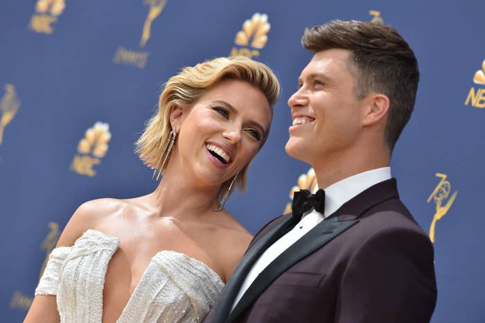 Scarlett Johansson and Colin Jost smile on the red carpet at the 70th Emmy Awards