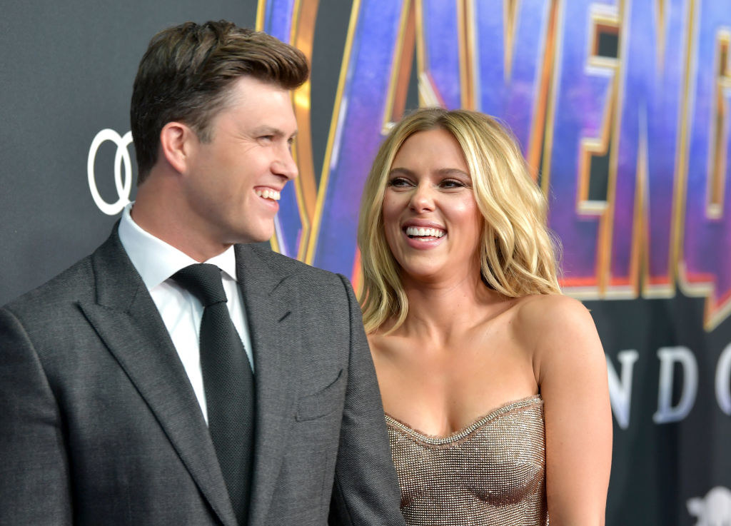 "Colin Jost and Scarlett Johansson laughing at the world premiere of Walt Disney Studios Motion Pictures ""Avengers: Endgame"" at the Los Angeles Convention Center in April 2019"