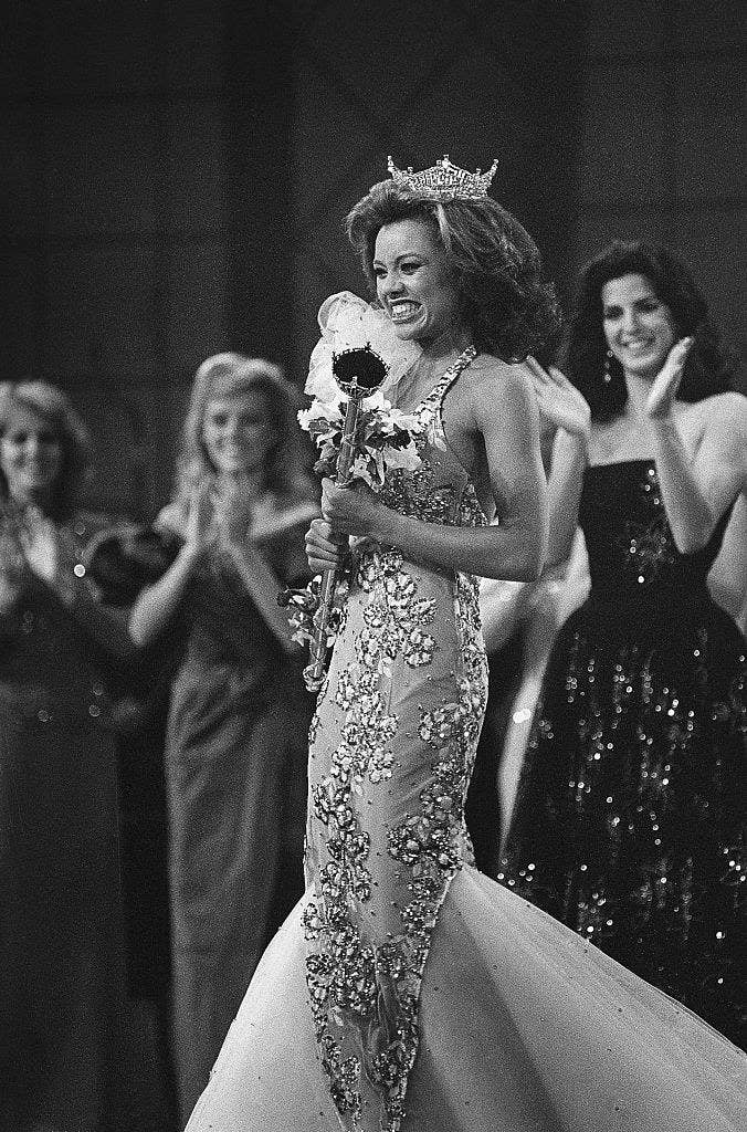 Crowned the new Miss America 1984, Miss New York, Vanessa L. Williams beams as she is applauded by runners-up Miss Virginia, Lisa Aliff (left), and Miss Ohio, Pamela Rigas (right)