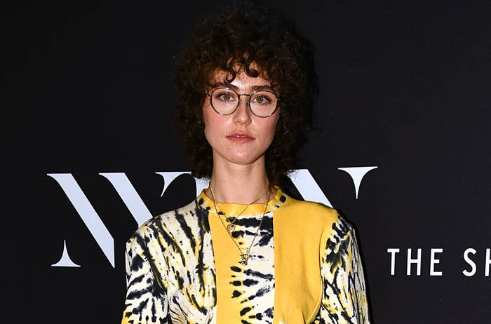 Ella wears a yellow and black tie dye shirt at a fashion week event