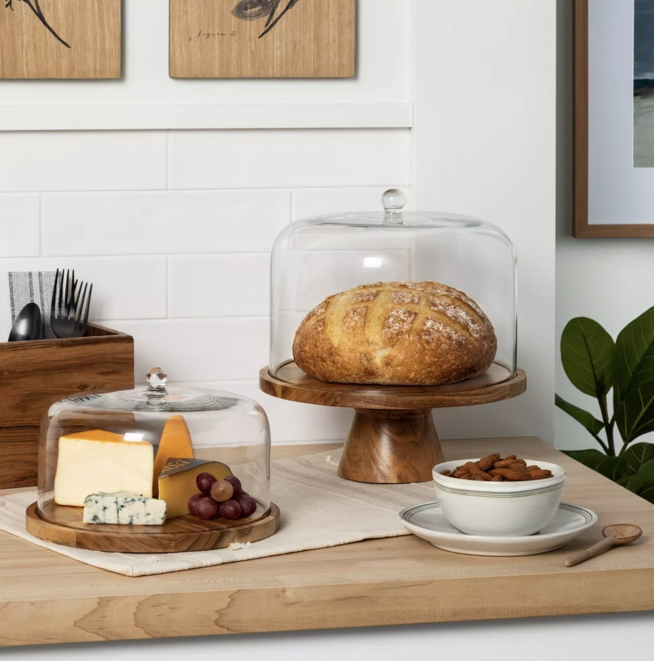 the cake stand with bread in it