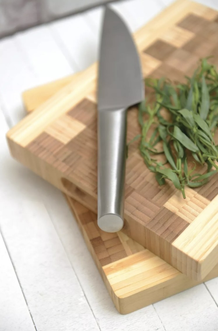 the checkered cutting board with dark and light wood