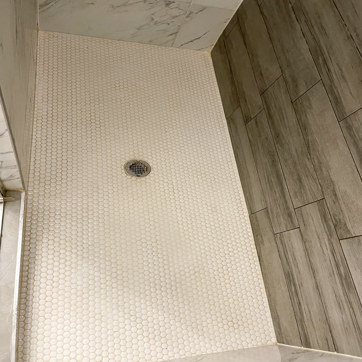 Same reviewer's after picture of perfectly clean shower tiles