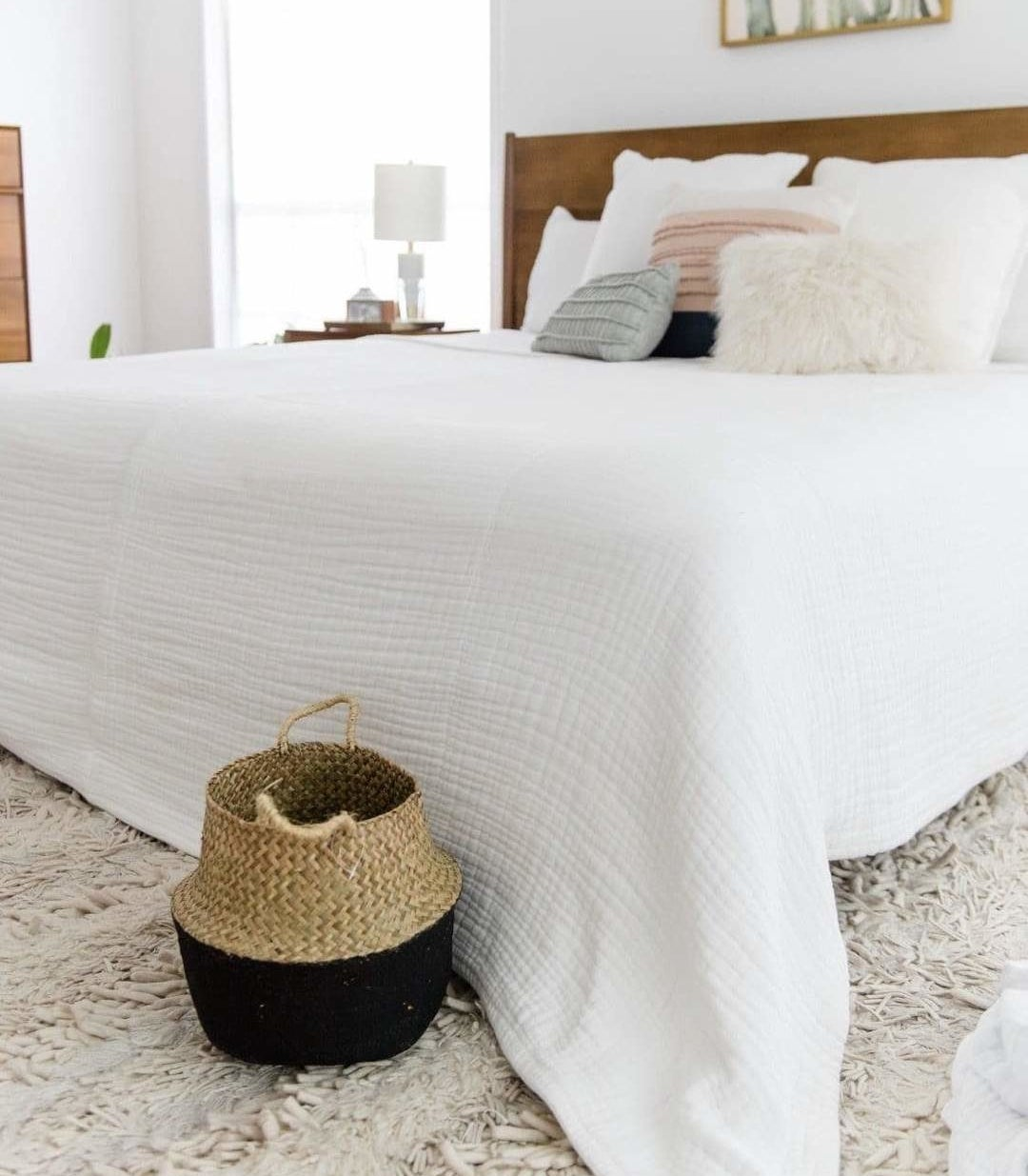 the arctic white 365 blanket on a bed in a minimally decorated bedroom