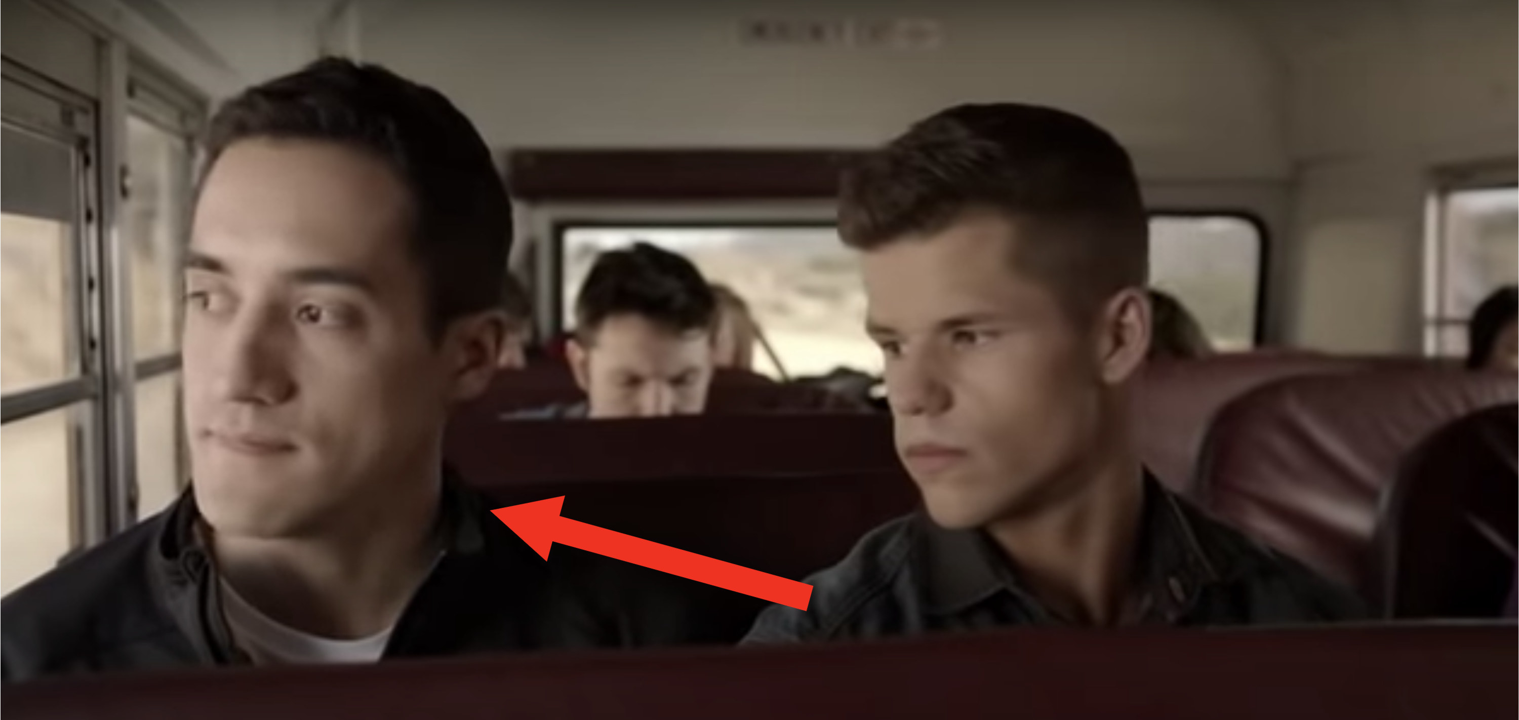 Danny sitting next to Ethan on the bus
