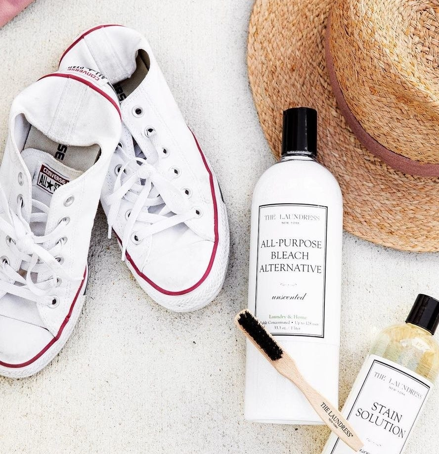 A flatlay of the bleach alternative next to some blindingly clean sneakers