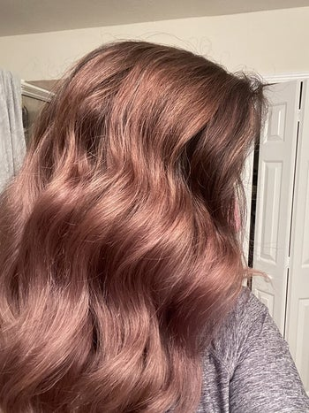 Reviewer showing hair after using argan oil mask