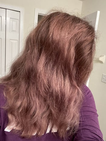 Reviewer showing hair before using argan oil mask