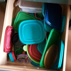 a reviewer's drawer with a chaotic mess of lids