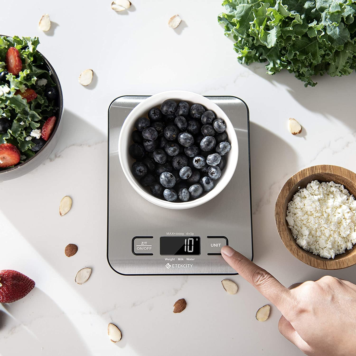 Model pressing digital display on small stainless steel scale