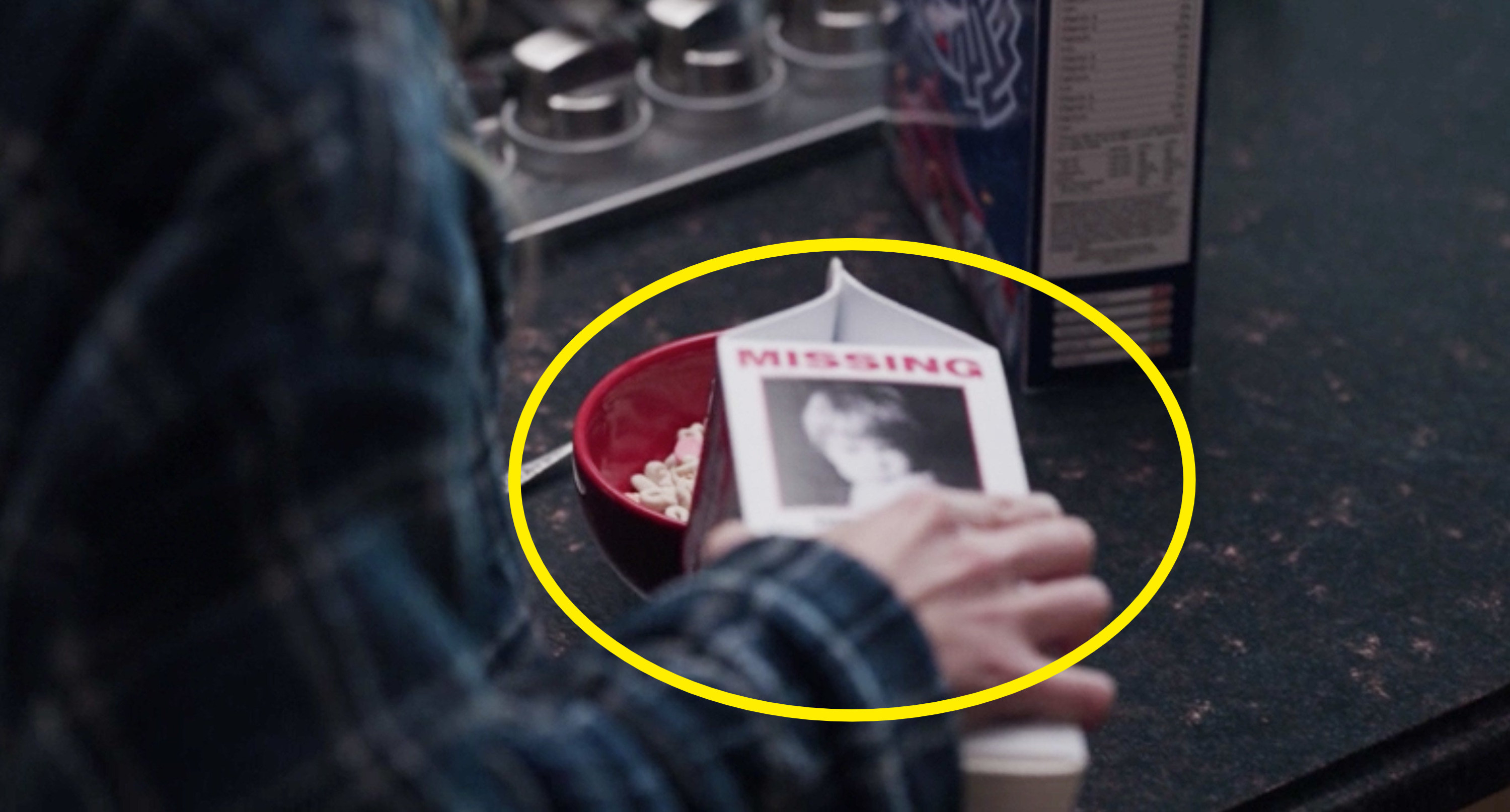 Wanda pouring milk from a carton that features a photo of a missing child