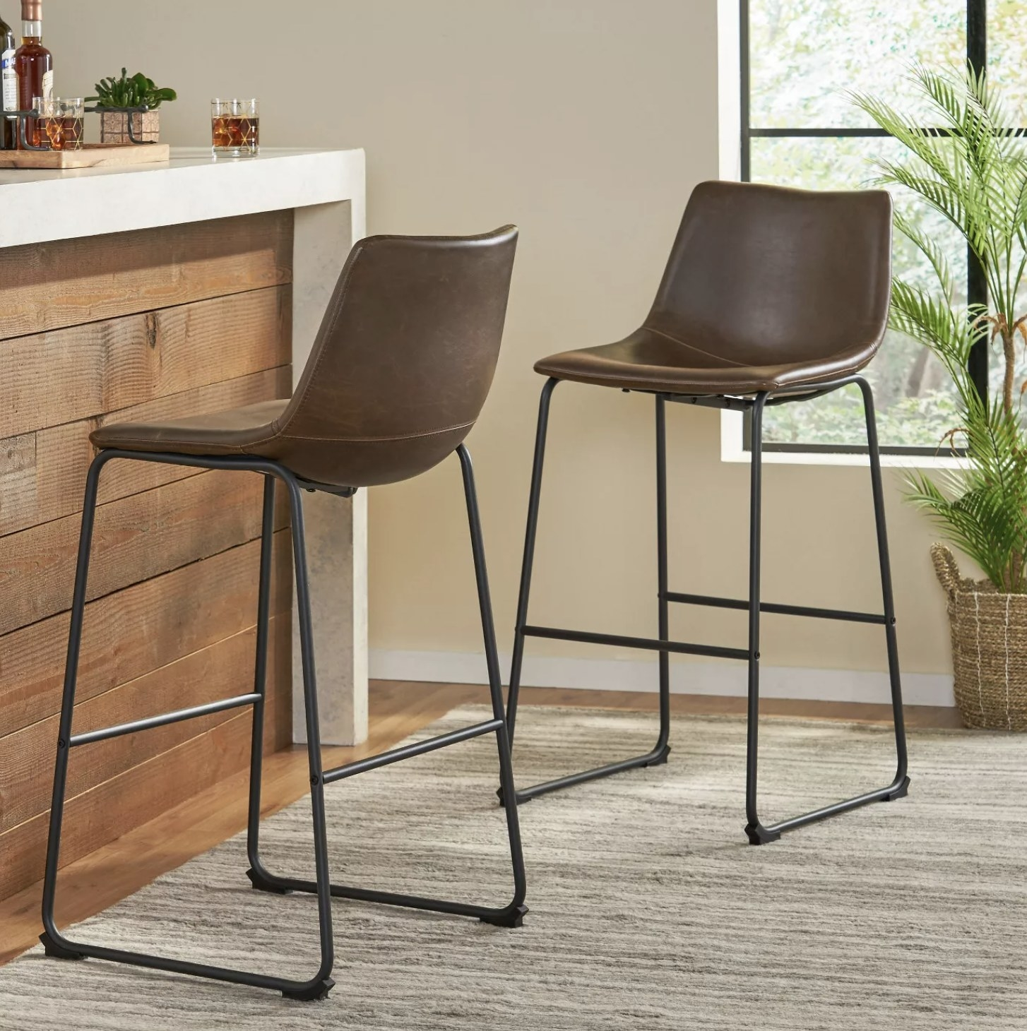 Two brown faux leather barstools