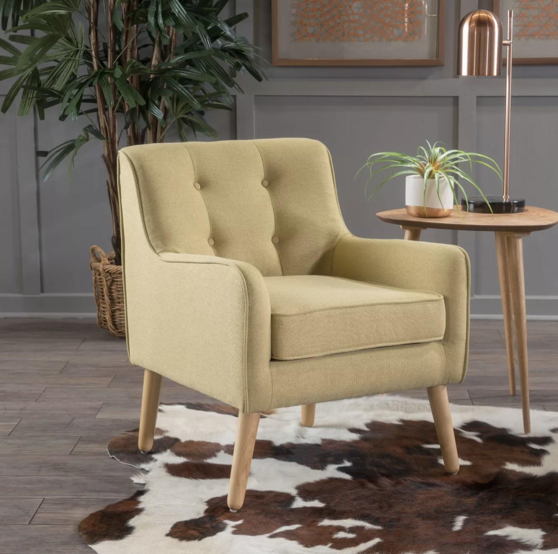 A pale green armchair