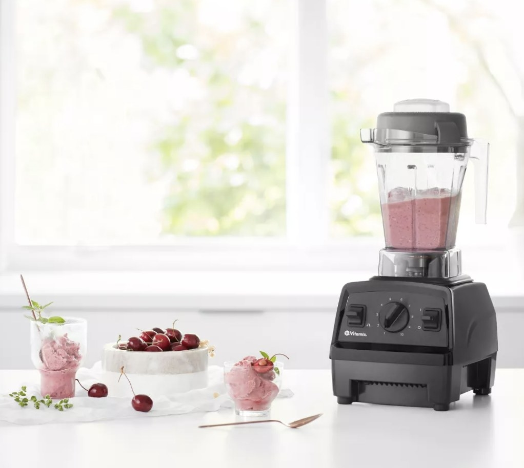 The Vitamix blender with a smoothie inside