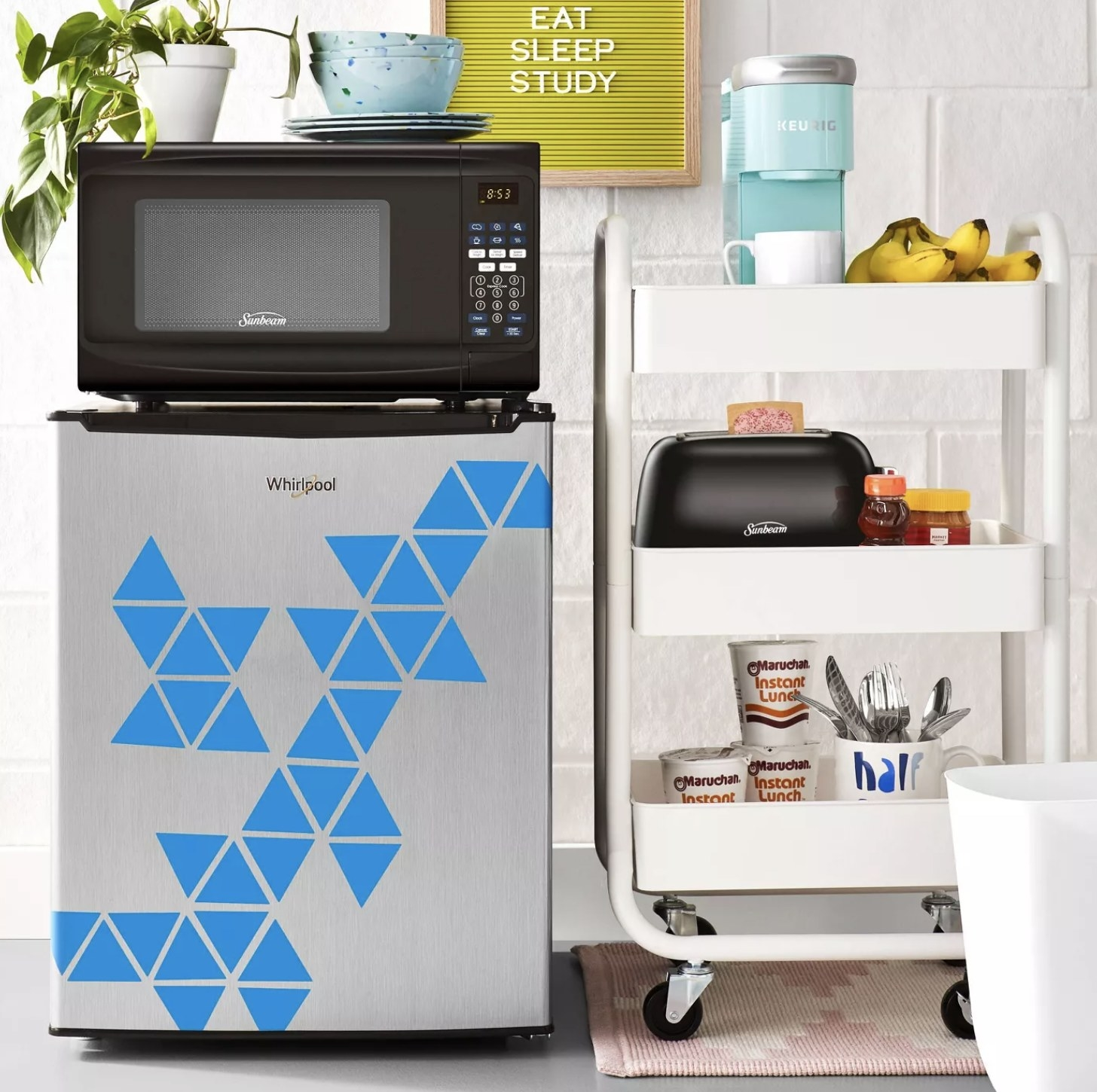 The mini refrigerator with decals on it