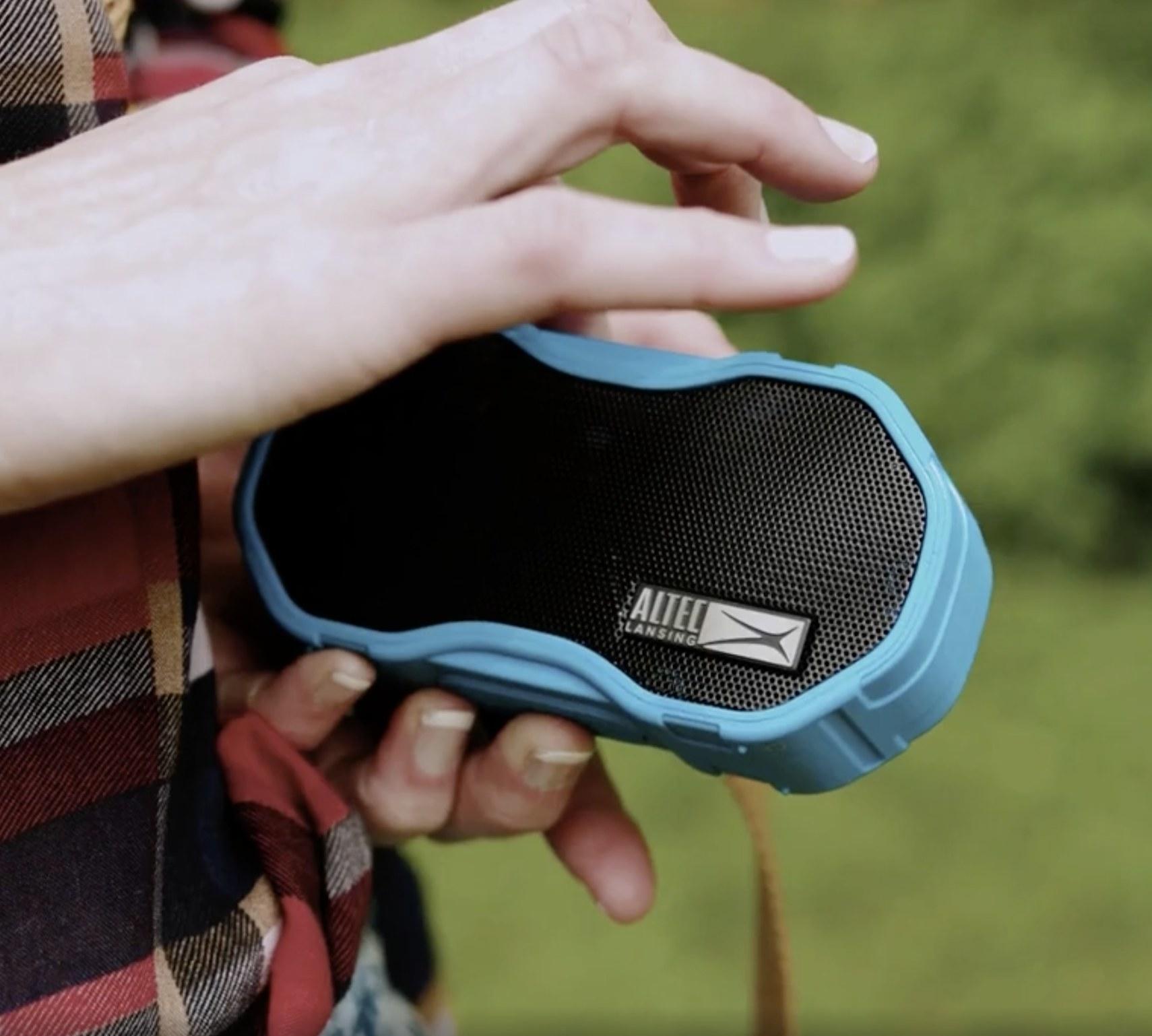 A blue Bluetooth speaker