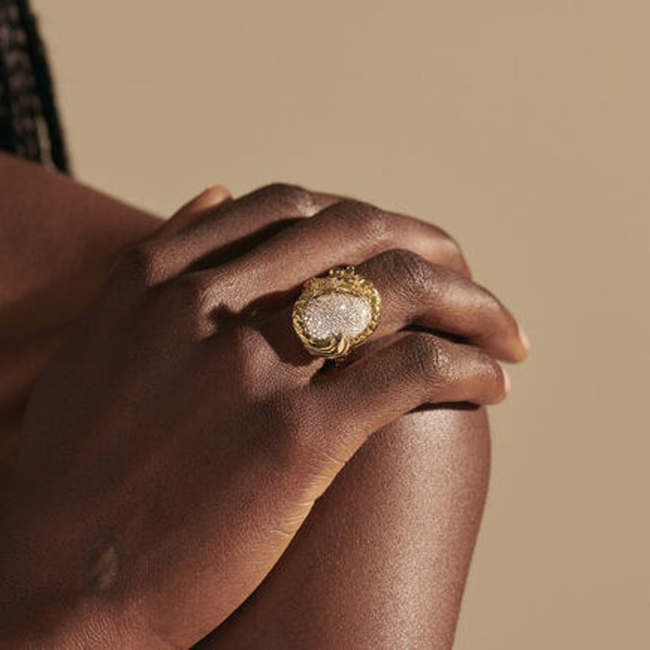 A model wearing the ring with their hand on their shoulder