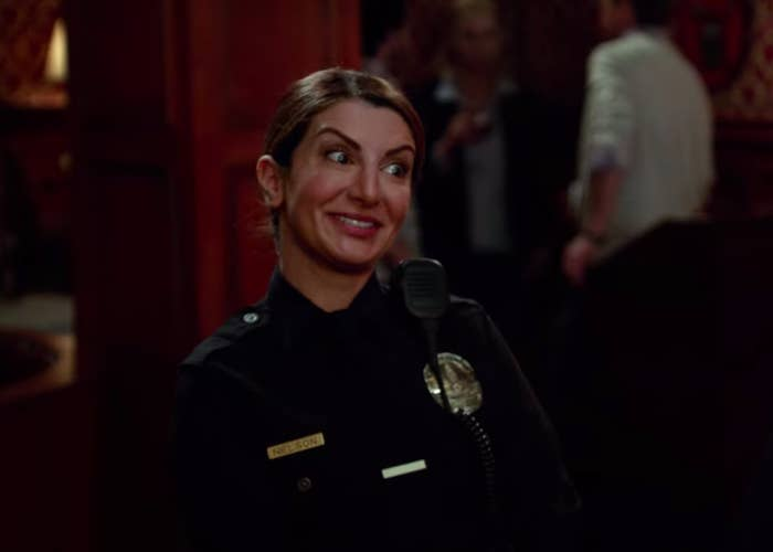 """Police officer Aly Nelson from """"New Girl"""" smiling"""