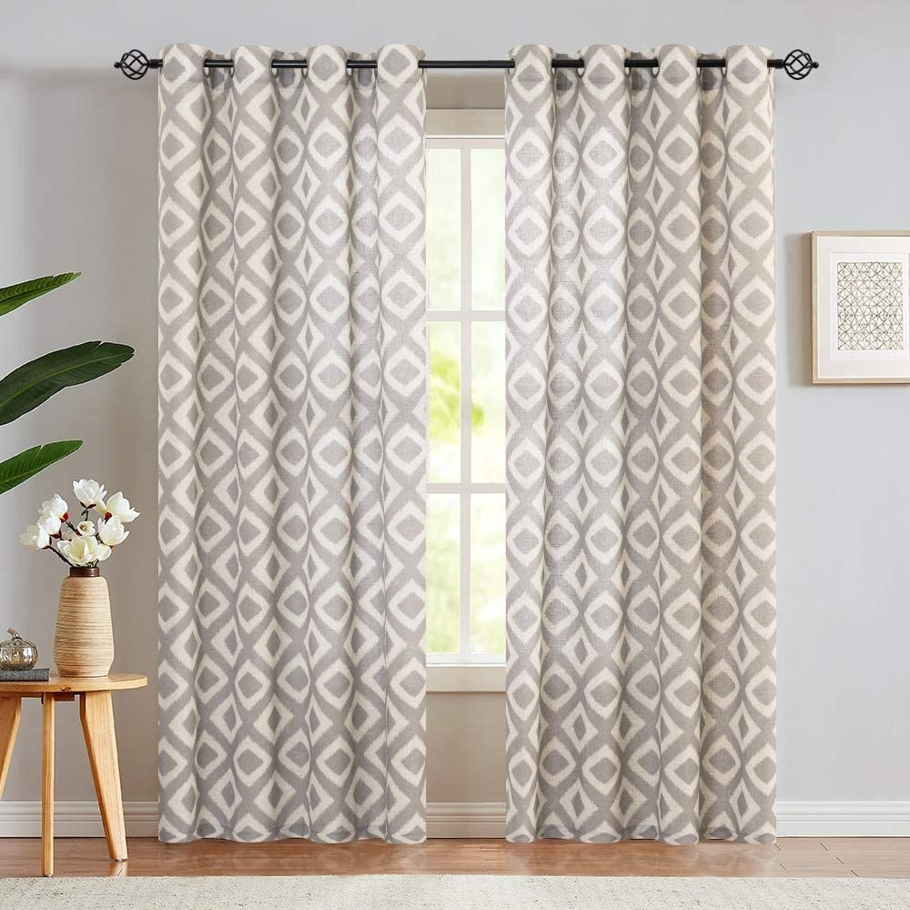 Gray and cream curtains that fall to the floor