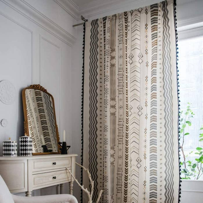 Geometric curtain with tassels on the edges