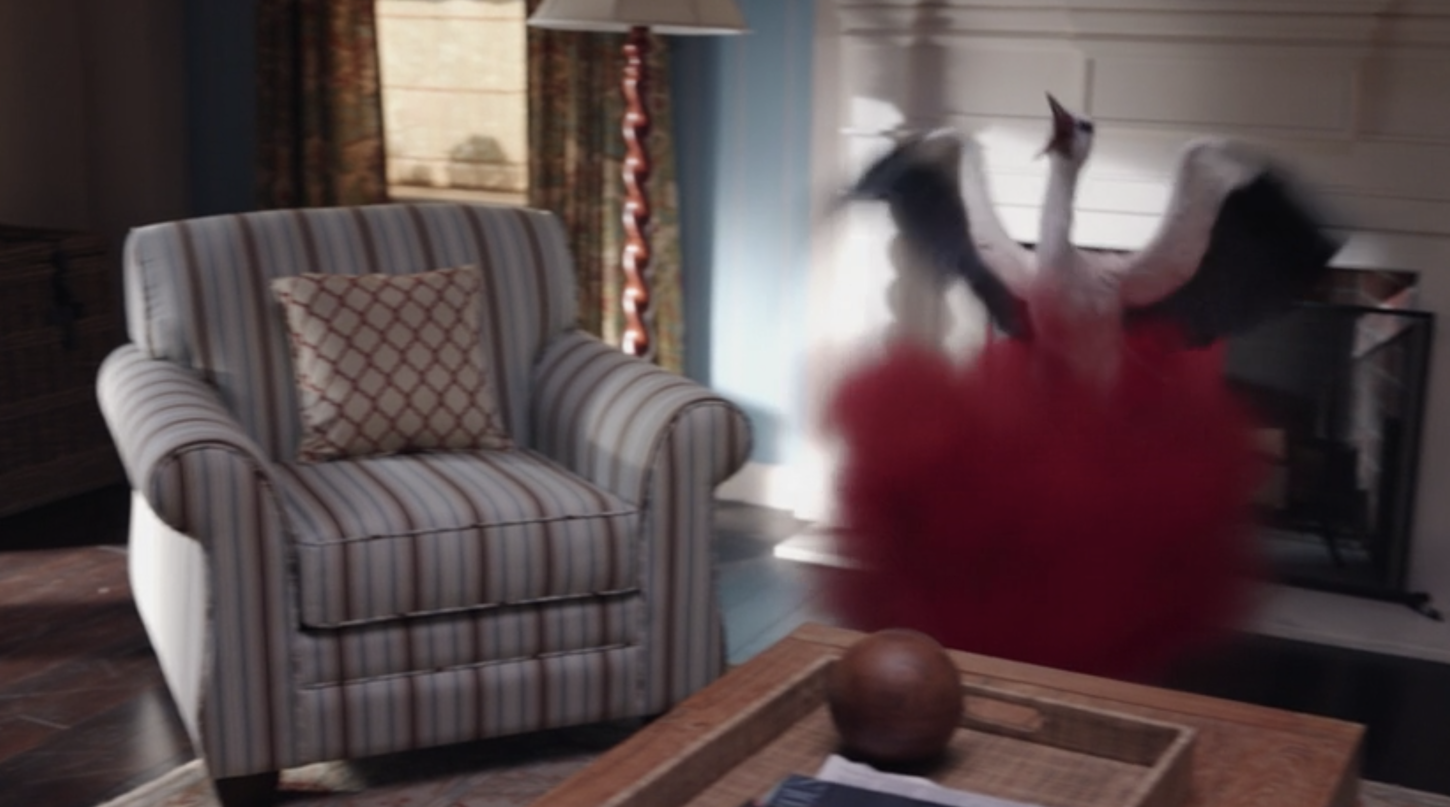A stork appearing inside a red cloud in Wanda's living room