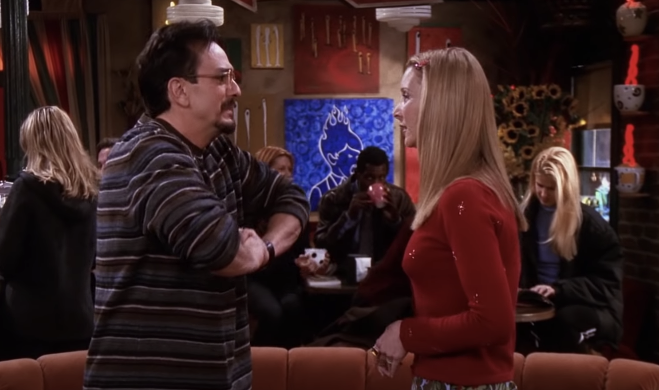 Phoebe and David standing in Central Perk