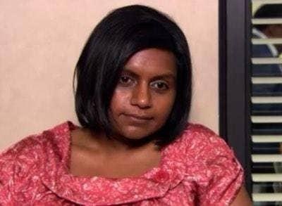 Kelly Kappoor in the office looking haggard and rundown