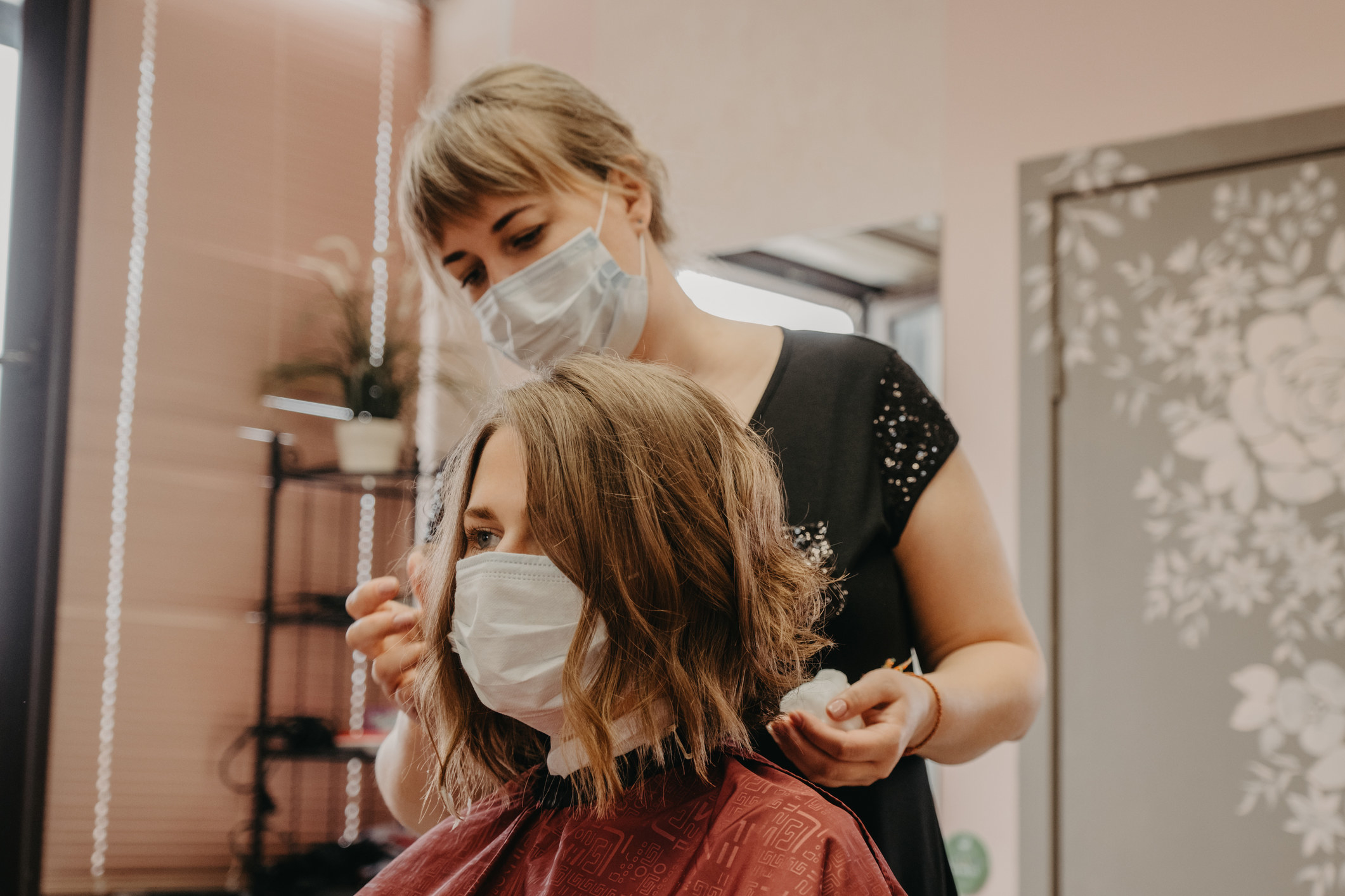 Person getting their hair styled