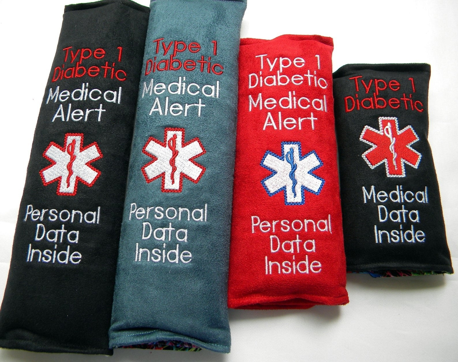 row of seat belt covers with Type 1 Diabetic medical alert on it