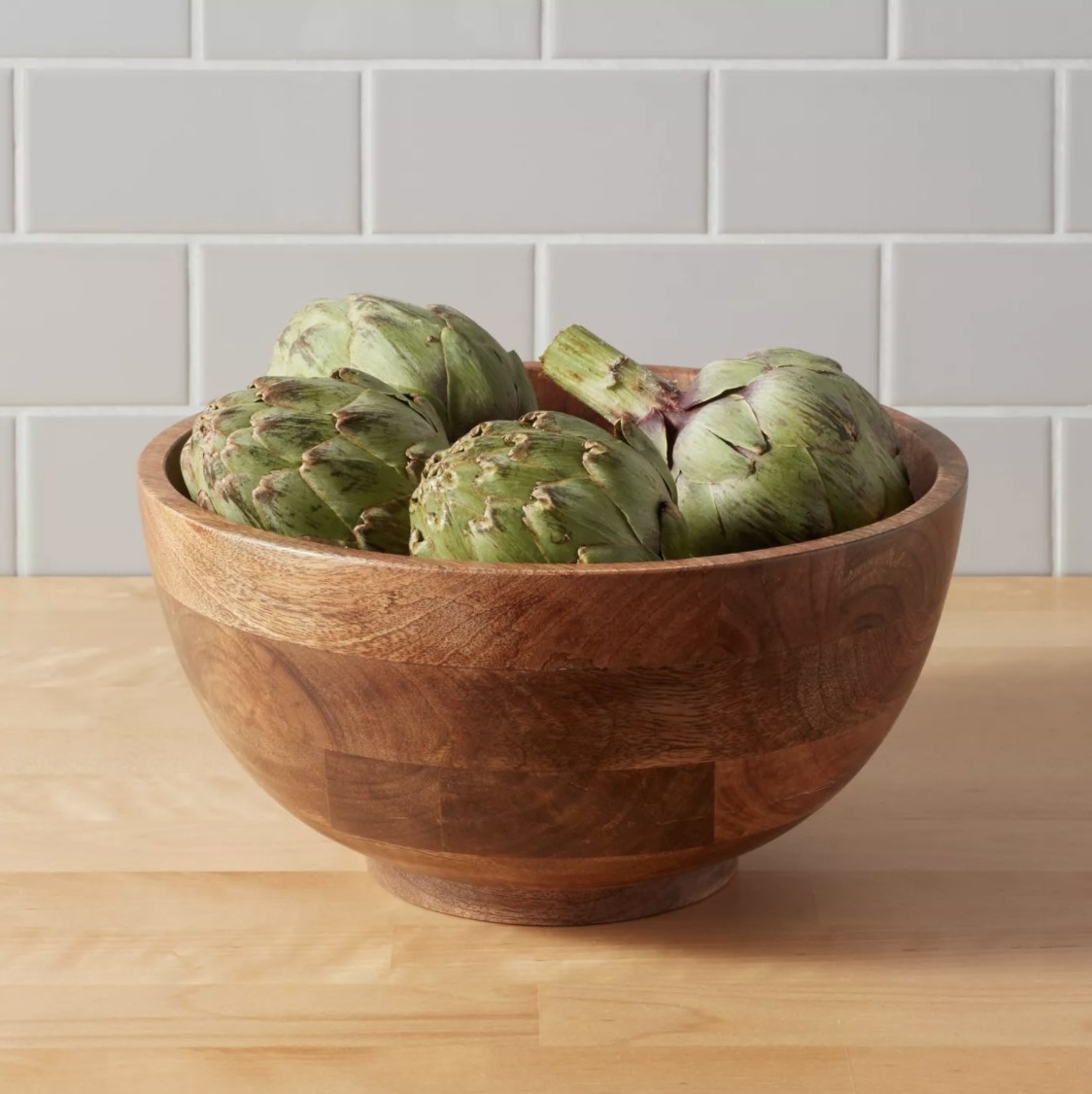 the bowl with artichokes in it