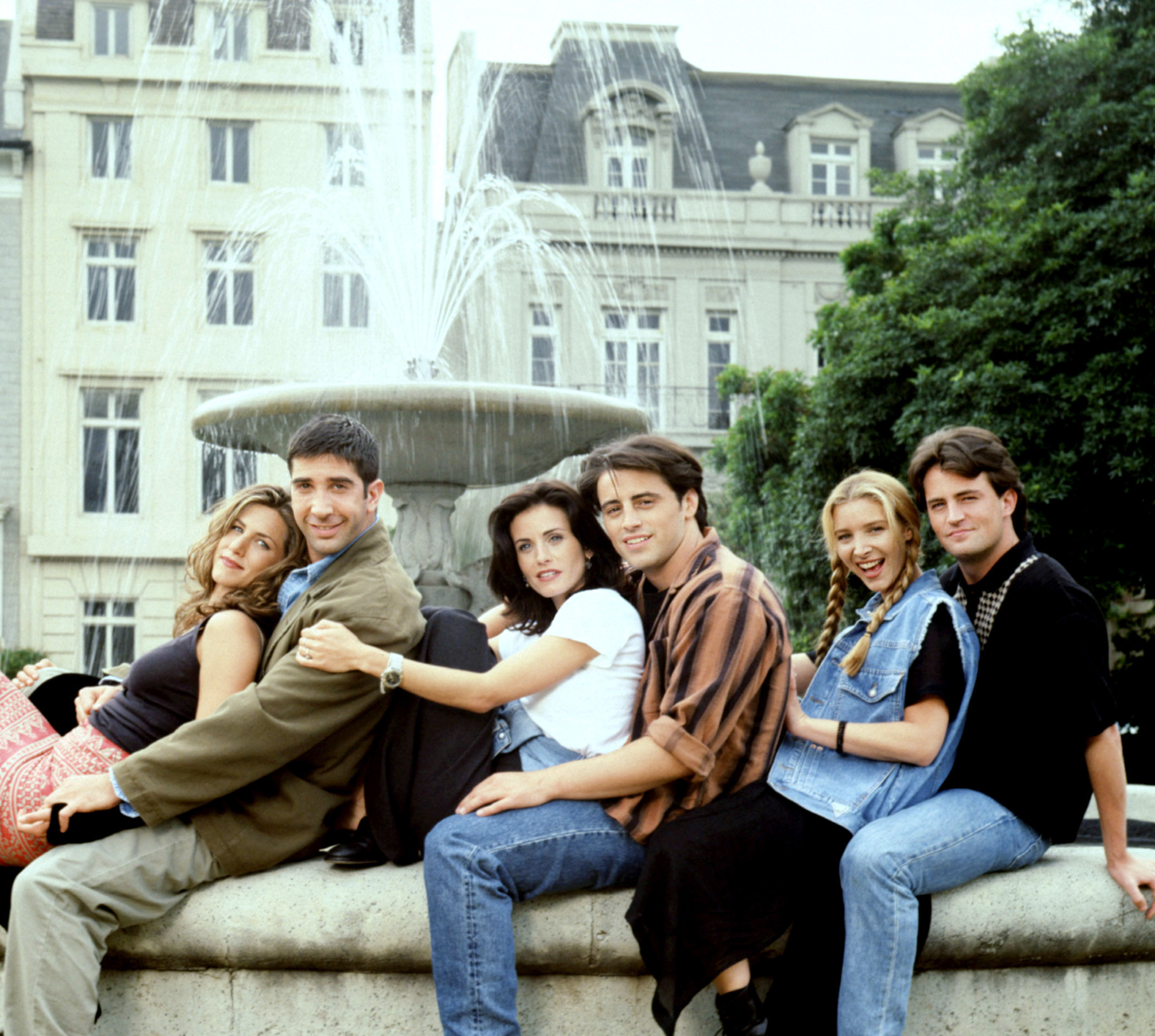 promo shot of the Friends outside the fountain with Joey behind Monica