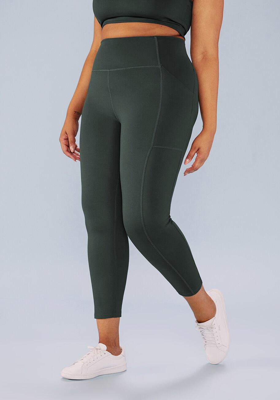 a model wearing the green leggings