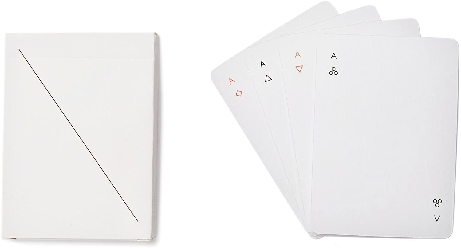 A set of white playing cards with simple red and white suit markers in the corners